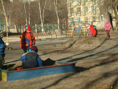 children in the kindergarten #33 of Dalnegorsk City, playing on cleaned up playground, October 2007, photo by Petr Sharov
